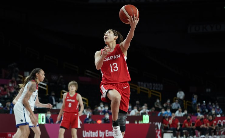 Japan's Rui Machida (13) drives to the basket during women's basketball gold medal game against the United States at the 2020 Summer Olympics, Sunday, Aug. 8, 2021, in Saitama, Japan. AP