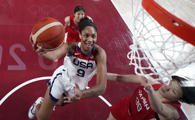 United States's A'Ja Wilson (9) drives past Japan's Himawari Akaho (88) during a women's gold medal basketball game at the 2020 Summer Olympics, Sunday, Aug. 8, 2021, in Saitama, Japan. AP