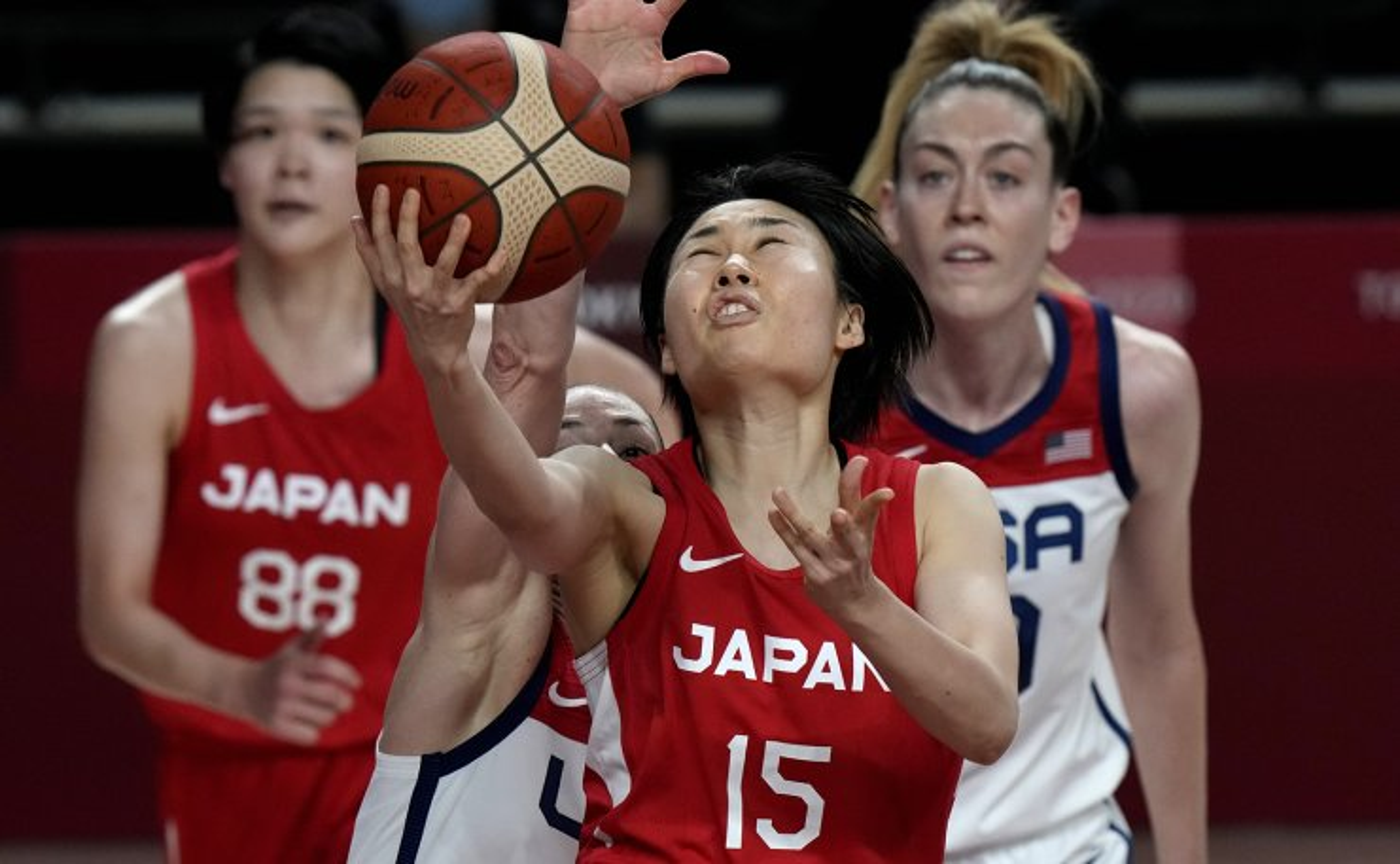 Japan's Nako Motohashi (15) drives ahead of United States' Breanna Stewart (10), right, during women's basketball gold medal game at the 2020 Summer Olympics, Sunday, Aug. 8, 2021, in Saitama, Japan. AP