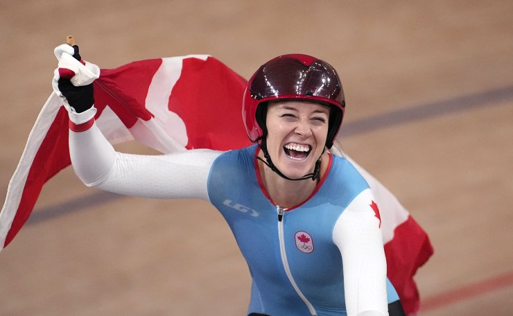 Kelsey Mitchell of Team Canada reacts after winning the gold medal during the track cycling women's sprint race at the 2020 Summer Olympics, Sunday, Aug. 8, 2021, in Izu, Japan. AP
