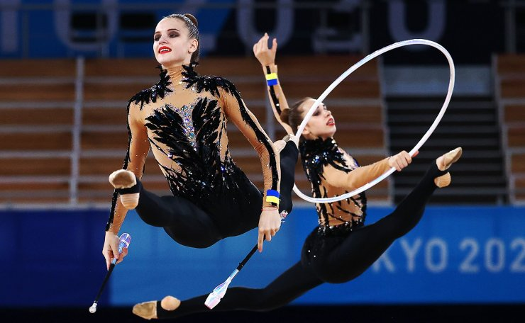 Tokyo 2020 Olympics - Gymnastics - Rhythmic - Group All-Around - Final - Rotation 2 - Ariake Gymnastics Centre, Tokyo, Japan - August 8, 2021. Team Ukraine in action with clubs and hoops. REUTERS