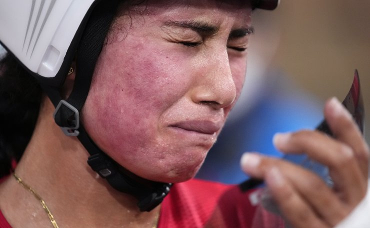 Ebtissam Zayed Ahmed of Team Egypt reacts after falling during the track cycling women's omnium points race at the 2020 Summer Olympics, Sunday, Aug. 8, 2021, in Izu, Japan. AP