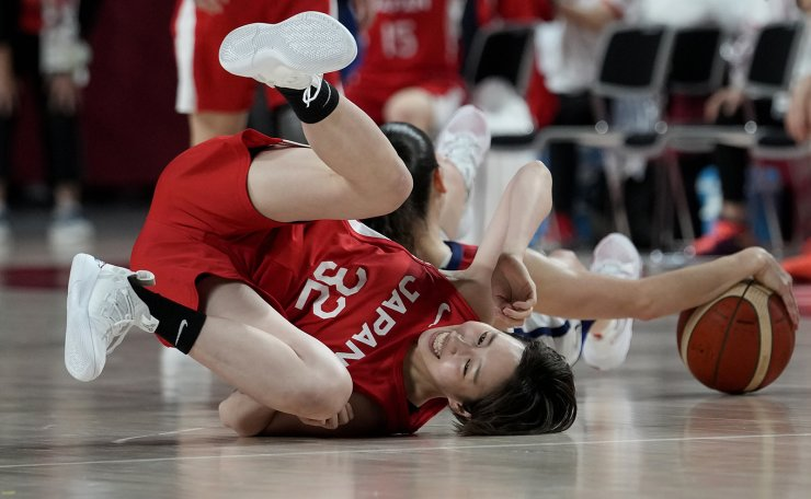 Japan's Saori Miyazaki (32) and United States's Sue Bird (6), rear, fight for a loose ball during women's basketball gold medal game at the 2020 Summer Olympics, Sunday, Aug. 8, 2021, in Saitama, Japan. AP