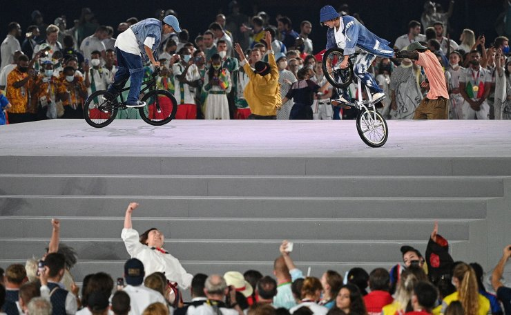 Performers display bicycle acrobatics during the closing ceremony of the Tokyo 2020 Olympic Games, on August 8, 2021 at the Olympic Stadium in Tokyo. AFP
