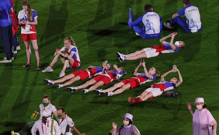 Russian athletes lay on the field during the Closing Ceremony of the Tokyo 2020 Olympic Games at the Olympic Stadium in Tokyo, Ja?pan, 08 August 2021.  EPA