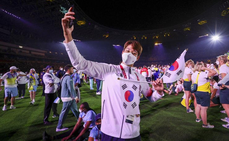 An athlete of South Korea poses during the closing ceremony in the Olympic Stadium at the 2020 Summer Olympics, Sunday, Aug. 8, 2021, in Tokyo, Japan. AP