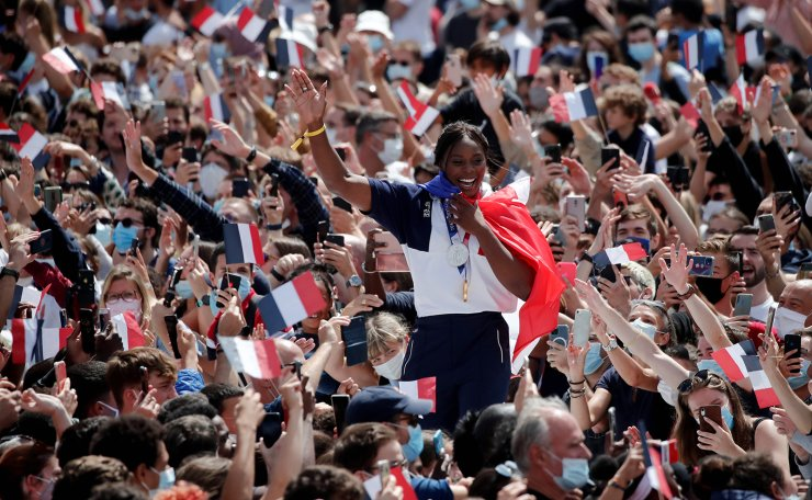 Gold medalist Clarisse Agbegnenou of France cheers the crowd as she arrives at Paris' Olympics fan zone to watch the closing ceremony of the Tokyo games, in front of the Eiffel Tower, at Trocadero Gardens in Paris, France, August 8, 2021. REUTERS