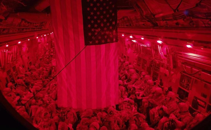 In this image made through a night vision scope and provided by the Minnesota National Guard, Minnesota National Guard Task Force 1-194 soldiers fly on a C-17 Globemaster en route to Hamid Karzai International Airport in Kabul, Afghanistan, on Monday, Aug. 23, 2021. AP