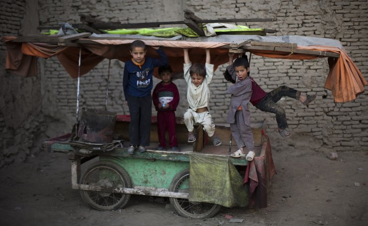 In this Sunday, Oct. 31, 2010 file photo, children play on a market cart in the old part of Kabul, Afghanistan. AP