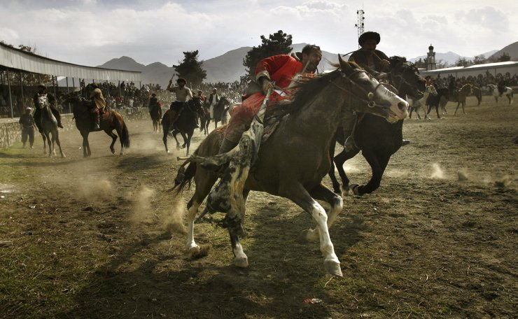 In this Tuesday, March 21, 2006 file photo, men play the traditional game Buzkashi in Kabul, Afghanistan, in a special match held as part of celebrations for the New Year. According the solar calendar used in Afghanistan, the year is 1385. AP