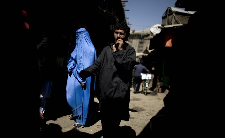 In this Monday, July 12, 2010 file photo, people walk through a market in downtown Kabul, Afghanistan. AP