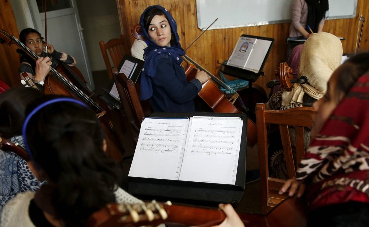 Fakria Azizi, a member of the Zohra orchestra, an ensemble of 35 women, practises during a session, at Afghanistan's National Institute of Music, in Kabul, Afghanistan April 4, 2016. REUTERS