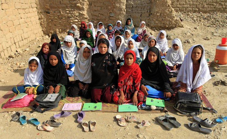 Teacher Mahajera Armani and her class of girls pose for a picture at their study open area, founded by Bangladesh Rural Advancement Committee (BRAC), outside Jalalabad city, Afghanistan September 19, 2015.  REUTERS