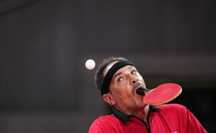 Egypt's Ibrahim Elhusseiny Hamadtou makes a first serve during the men's table tennis singles (Class 6) Group match against China's Chao Chen at the Tokyo 2020 Paralympic Games at Tokyo Metropolitan Gymnasium in Tokyo on August 27, 2021. AFP