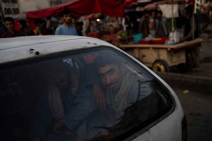 Two Afghans sit inside the trunk of a car in Kabul's Old City, Afghanistan, Tuesday, Sept. 14, 2021. It is feared Afghanistan could further plunge toward famine and economic collapse after the chaos of the past month, which saw the Taliban oust the government in a lightning sweep as U.S. and NATO forces exited the 20-year war. AP