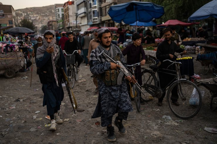 Taliban fighters patrol a market in Kabul's Old City, Afghanistan, Tuesday, Sept. 14, 2021. AP