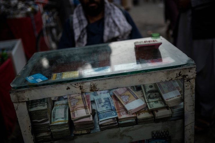 An Afghan money changer waits for customers in Kabul's Old City, Afghanistan, Tuesday, Sept. 14, 2021. AP