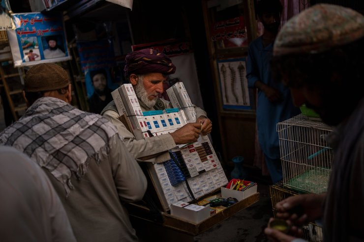A street vendor sells tobacco in Kabul's Old City, Afghanistan, Tuesday, Sept. 14, 2021. AP