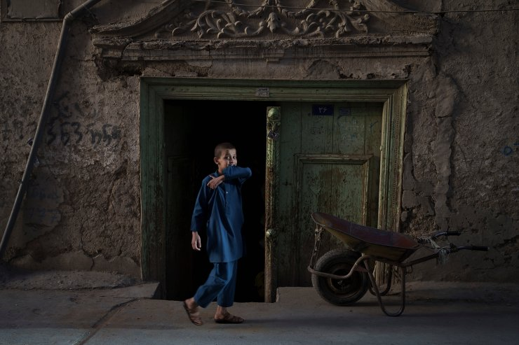 A boy plays outside his home in Kabul's Old City, Afghanistan, Wednesday, Sept. 15, 2021. AP