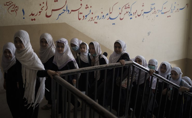 Girls walk upstairs as they enter a school before class in Kabul, Afghanistan, Sunday, Sept. 12, 2021. AP