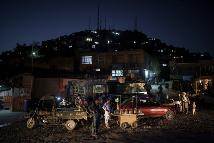 Afghan street vendors wait for customers at night in Kabul, Afghanistan, Thursday, Sept. 16, 2021. AP