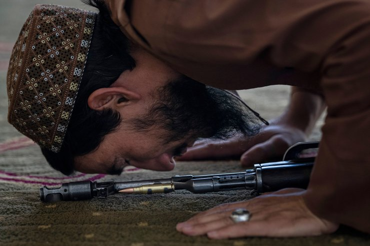 A Taliban fighter prays at a mosque during Friday prayers in Kabul, Afghanistan, Friday, Sept. 17, 2021. AP