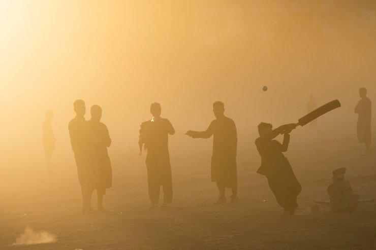 Afghans play cricket at the Chaman-e-Hozari Park in Kabul, Afghanistan, Friday, Sept. 17, 2021. AP