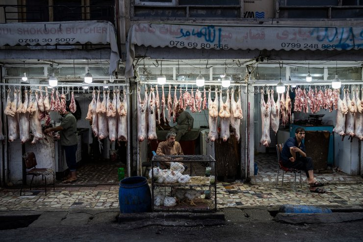 Butchers wait for customers in Kabul, Afghanistan, Monday, Sept. 20, 2021. AP