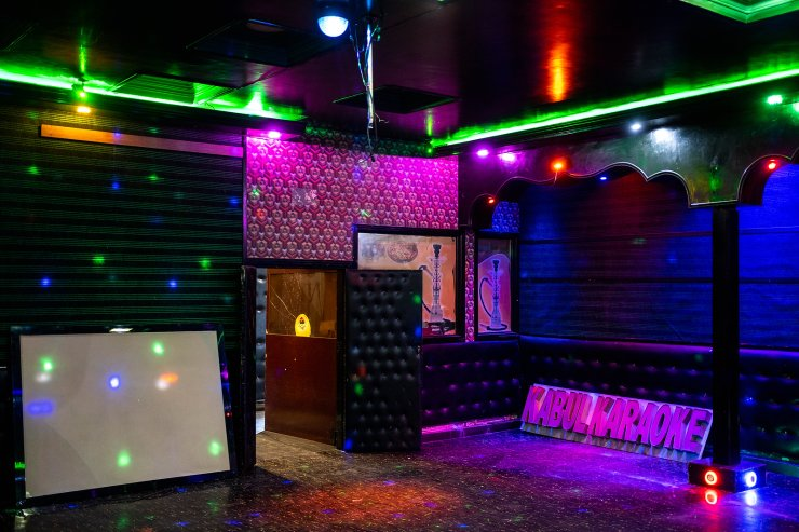 Lights shine at a no longer operative Karaoke hall in Kabul, Afghanistan, Tuesday, Sept. 21, 2021. AP