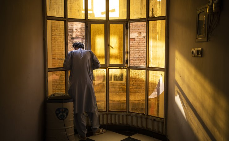 An Afghan singer looks out a window in Kabul, Afghanistan, Tuesday, Sept. 14, 2021. AP