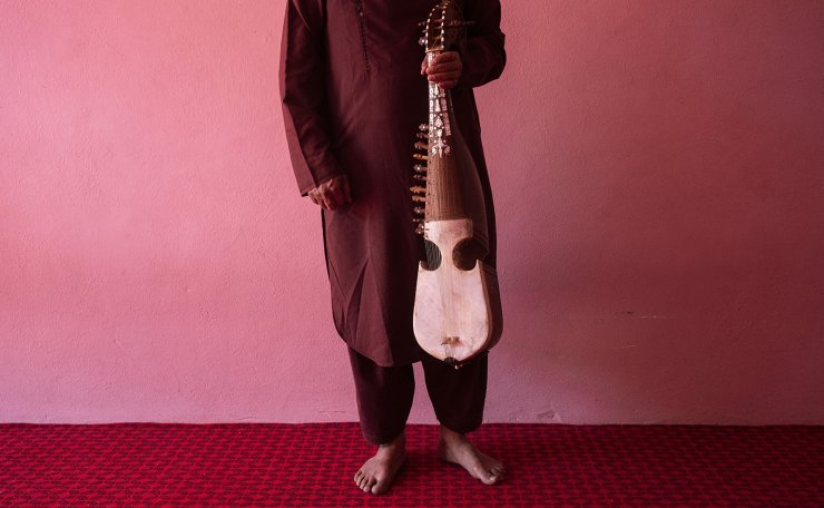 An Afghan musician poses for a portrait with his rubab in Kabul, Afghanistan, Thursday, Sept. 16, 2021. About a month after the Taliban seized power in Afghanistan, the music is starting to go quiet. The last time that the militant group ruled the country, in the late 1990s, it outright banned music. AP