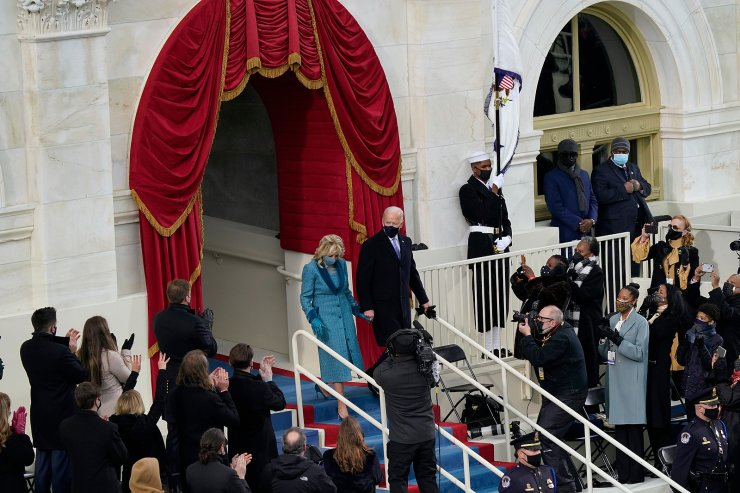 President-elect Joe Biden and his wife Jill, walk out for the 59th Presidential Inauguration at the U.S. Capitol in Washington, Wednesday, Jan. 20, 2021. AP