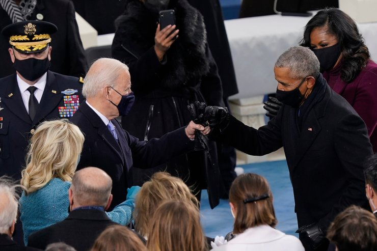 President-elect Joe Biden his greeted by former President Barrack Obama as he arrives for the 59th Presidential Inauguration at the U.S. Capitol in Washington, Wednesday, Jan. 20, 2021. AP