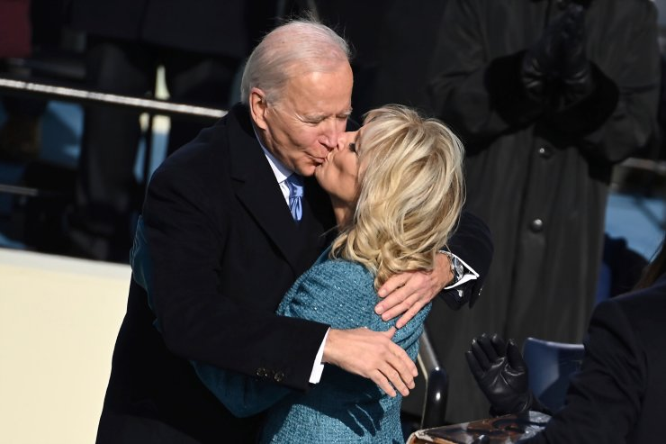 President Joe Biden gets a kiss from first lady  Jill Biden after he took the oath office during the inauguration at the U.S. Capitol in Washington, Wednesday, Jan. 20, 2021. AP