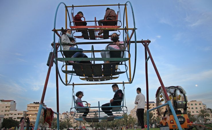 Children play at a park amid the COVID-19 pandemic in Gaza City, Dec. 28, 2020. Xinhua