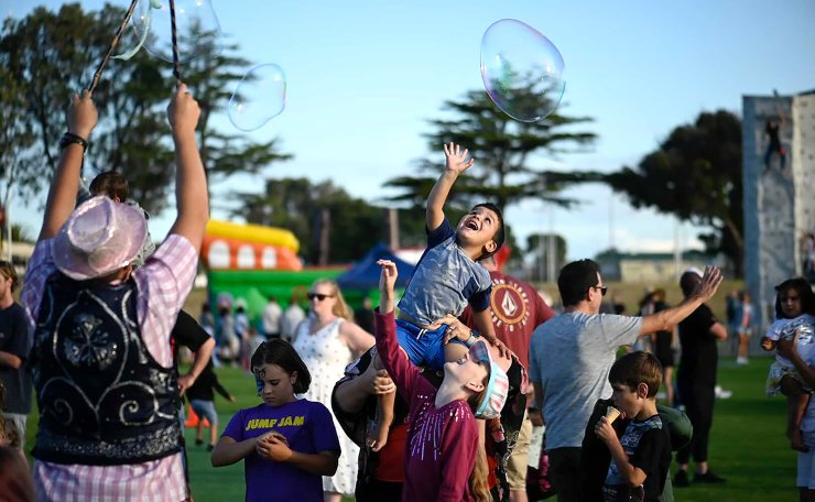 Children chase a giant soap bubble at the Blake Park, Mount Manganui, New Zealand as they enjoy New Year's Eve celebrations, Thursday, Dec. 31, 2020. New Zealand is one of the first countries in the world to welcome in the New Year. AP