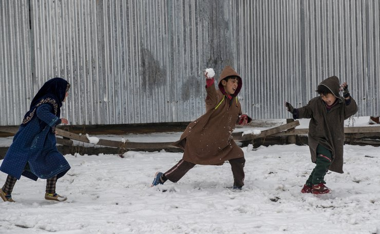Kashmiri children throw snow at each other after a fresh snow fall in Srinagar, Indian controlled Kashmir, Sunday, Jan. 3, 2021. AP