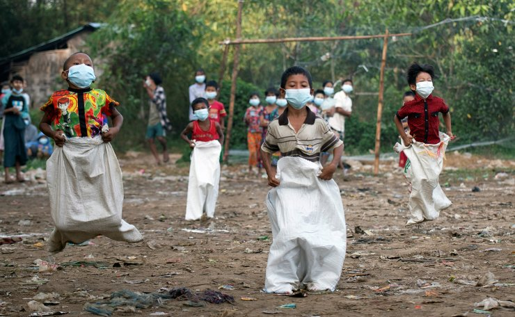 Children wearing face mask take part in a sack race contest during Myanmar's 73rd Independence Day celebrations amid the spread of the coronavirus disease (COVID-19) in Yangon, Myanmar, January 4, 2021. Reuters