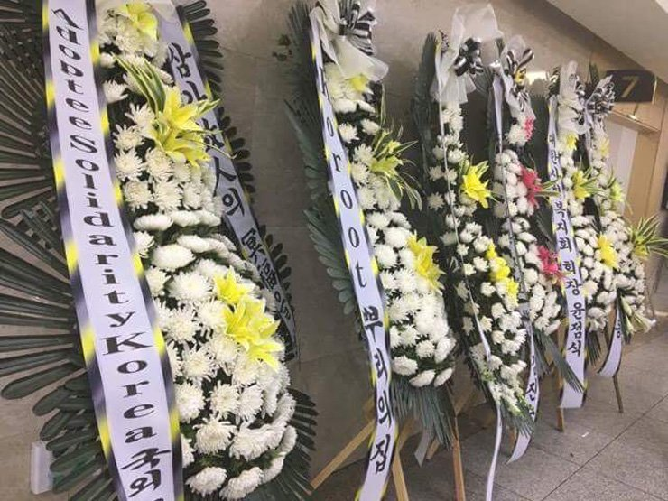 <span>Flowers sent by adoptee support organizations are lined up in commemoration of Phillip Clay, a deported adoptee. His funeral was held at Myongji University Hospital, Goyang, Gyeonggi Province, after his alleged suicide on May 21. / Courtesy of Simone Eun Mi</span><br /><br />