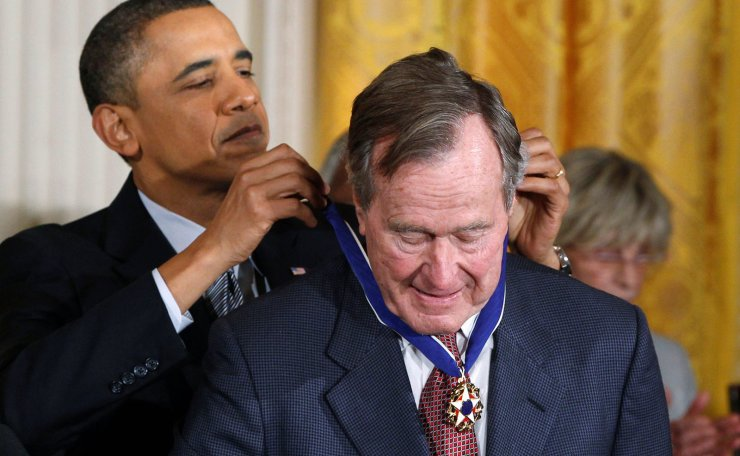 President Barack Obama awards the Medal of Freedom to former U.S. President George H.W. Bush during a ceremony at the White House in Washington February 15, 2011. Reuters