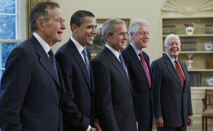 In this file photo from Wednesday, Jan. 7, 2009, former President George H.W. Bush, left, joins then President-elect Barack Obama, President George W. Bush, former President Bill Clinton and former President Jimmy Carter in the Oval Office at the White House in Washington, Wednesday, Jan. 7, 2009. George H.W. Bush has died at age 94. AP