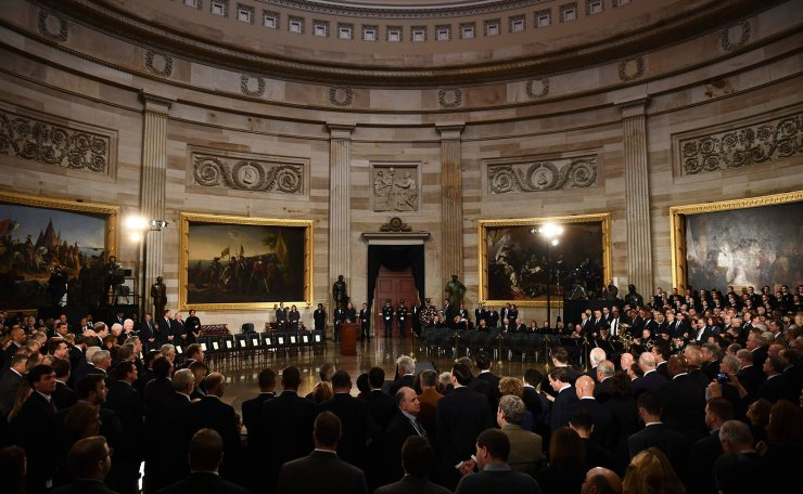 Attendees wait for the remains of former US President George H.W. Bush to arrive at the US Capitol during a State Funeral in Washington, DC, December 3, 2018. AFP