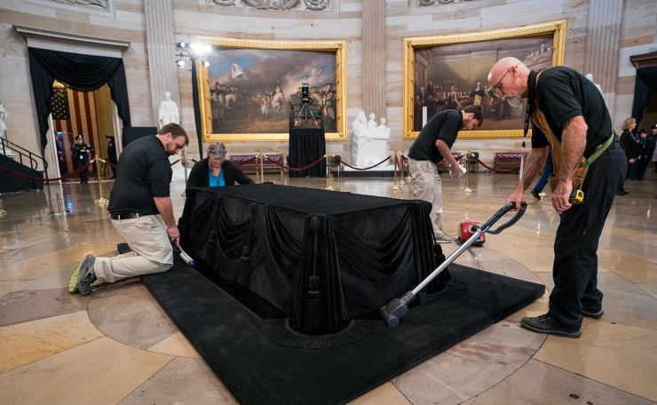 Workers clean and prepare Lincoln's catafalque for President George H. W. Bush to lie in state at the U.S. Capitol Rotunda, in Washington, D.C. on December 3, 2018. UPI