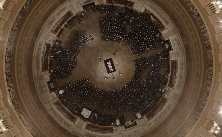 Vice President Mike Pence speaks as Former President George H. W. Bush lies in state in the U.S. Capitol Rotunda Monday, Dec. 3, 2018, in Washington. AP