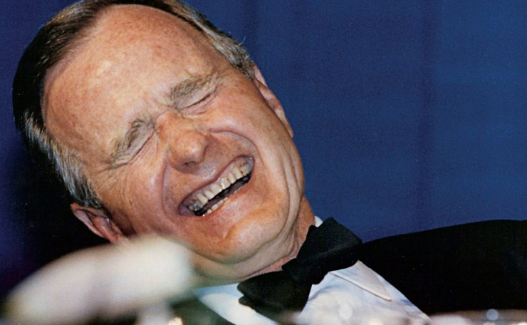 U.S. President George H.W. Bush laughs while attending the annual White House Correspondents Association Awards dinner in Washington May 21, 1988. Reuters