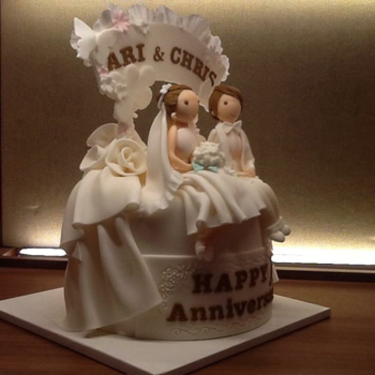 This wedding cake symbolizes the marriage of Chris and Ari, a Korean female couple who wed in Canada, 2013. / Courtesy of Chris and Ari