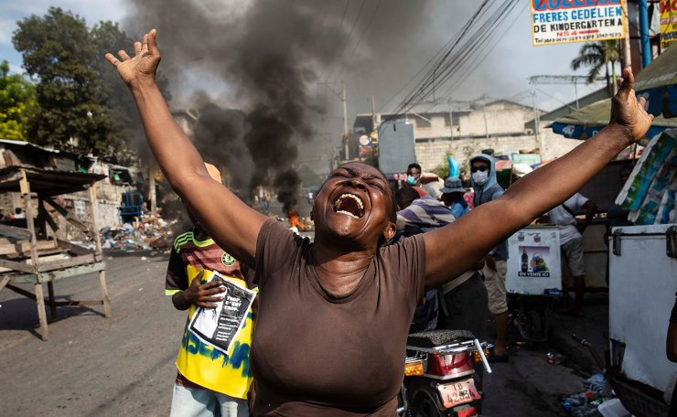 A woman shouts anti-government slogans during a protest organized by friends and relatives of Biana Velizaire, who was kidnapped and held for several days by gang members, in Port-au-Prince, Haiti, Monday, Sept. 27, 2021. Haitian police on Monday launched a special operation in response to the recent surge of kidnappings conducted by gangs. AP