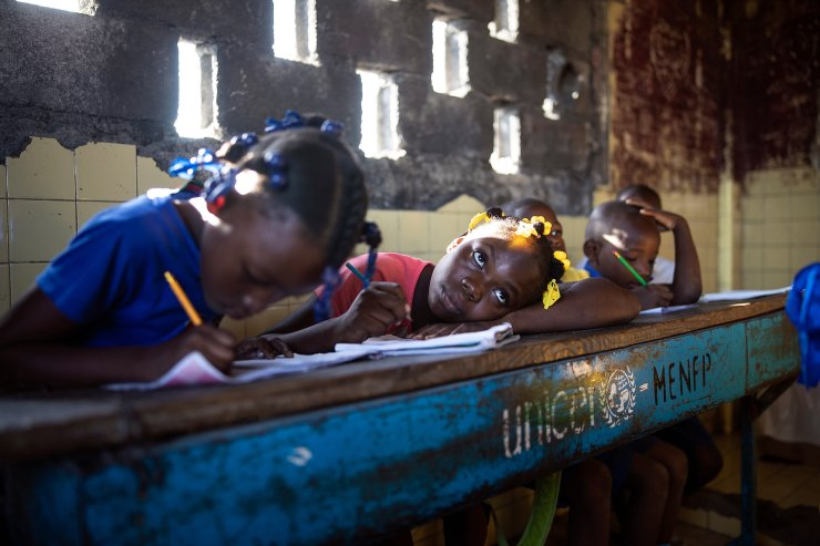 Students write in their notebooks while attending a class at Sante Bernadette school, inside Fort Dimanche, once a prison where late dictator Francois 'Papa Doc' Duvalier imprisoned his enemies in Port-au-Prince, Haiti, Thursday, Sept. 23, 2021. This week the school year began in Haiti. AP