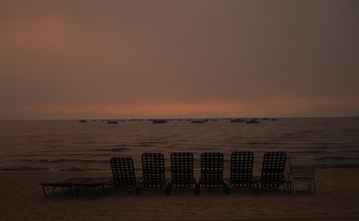 Chairs sit on the empty beach as smoke from the Caldor Fire fills the air in South Lake Tahoe, Calif., Tuesday, Aug. 31, 2021. A huge firefighting force gathered Tuesday to defend Lake Tahoe from the raging wildfire that forced the evacuation of California communities on the south end of the alpine resort and put others across the state line in Nevada on notice to be ready to flee. AP