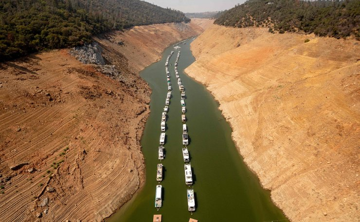 Houseboats sit in a narrow section of water in a depleted Lake Oroville in Oroville, California on September 5, 2021. AF